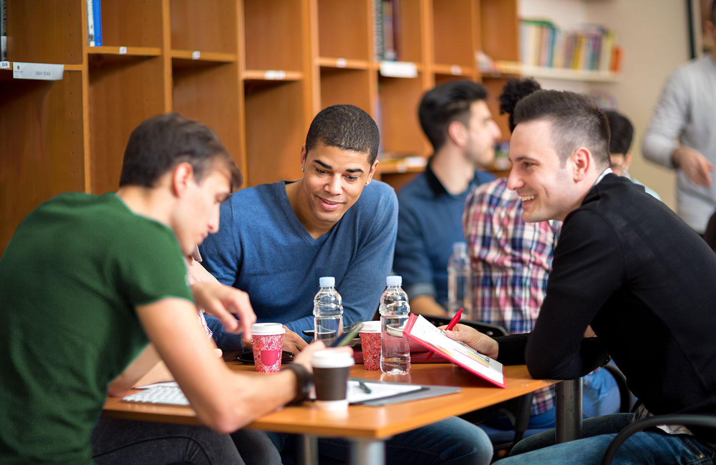 Male students work together in groups.
