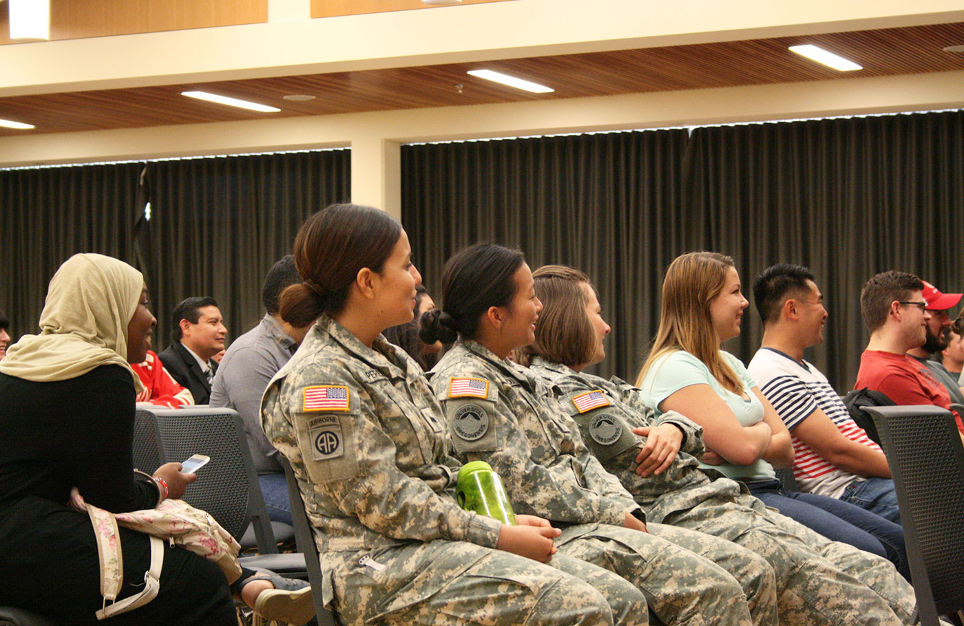 Students listen to Shoshanna Johnson speak in the Global Scholars Hall during veteran women's week.