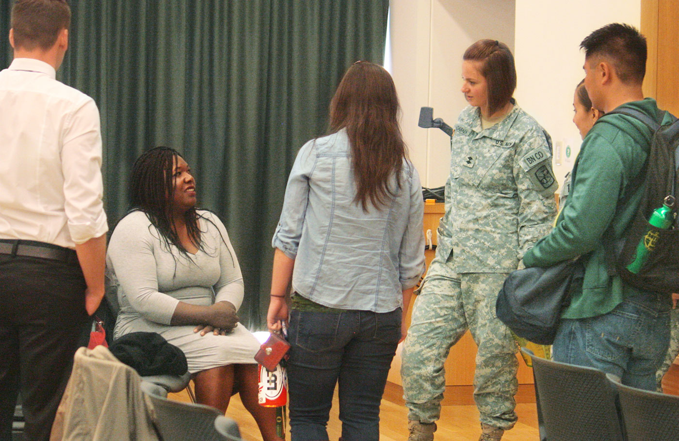 Students talk to Shoshanna Johnson—the first female, African American prisoner of war—after her talk in the Global Scholars Hall.