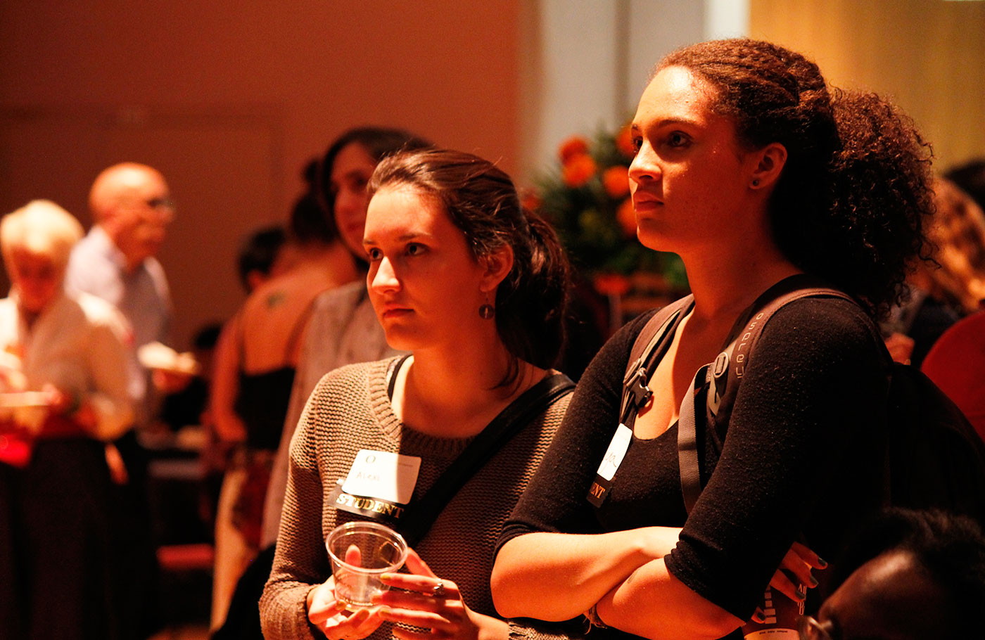 Crowds of students listen to speakers and enjoy refreshments at Weaving New Beginnings